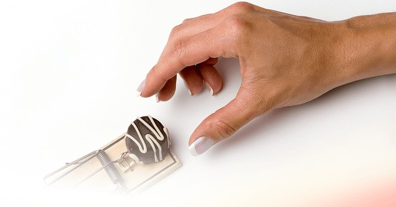 deprivation creates cravings - woman hand trying to get chocolate